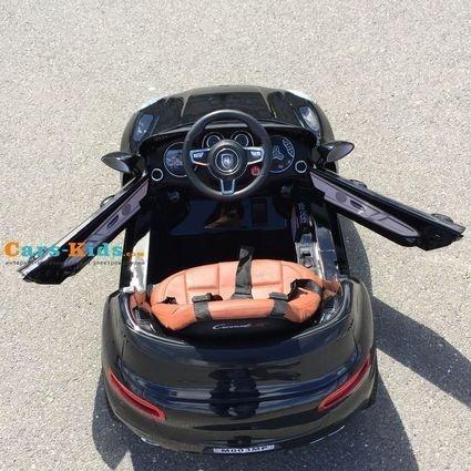 Электромобиль Porsche Macan черный (колеса резина, сиденье кожа, пульт, музыка)